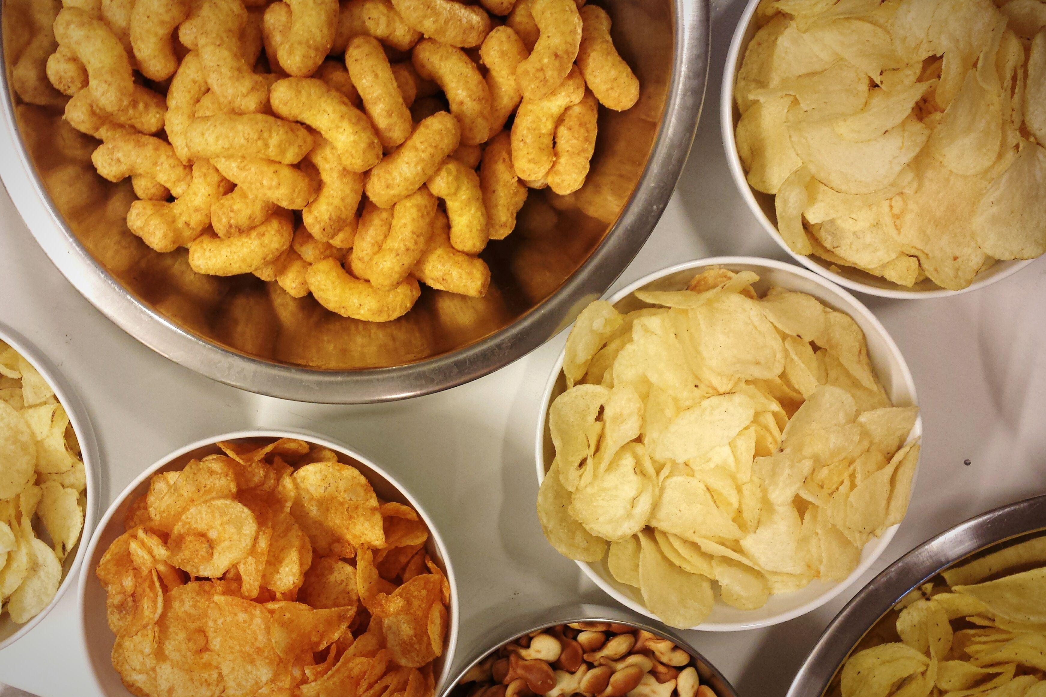 bowls of chips and snacks