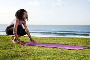 Woman Rolling Up Yoga Mat