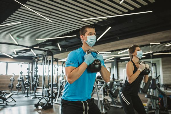 man working out wearing a mask
