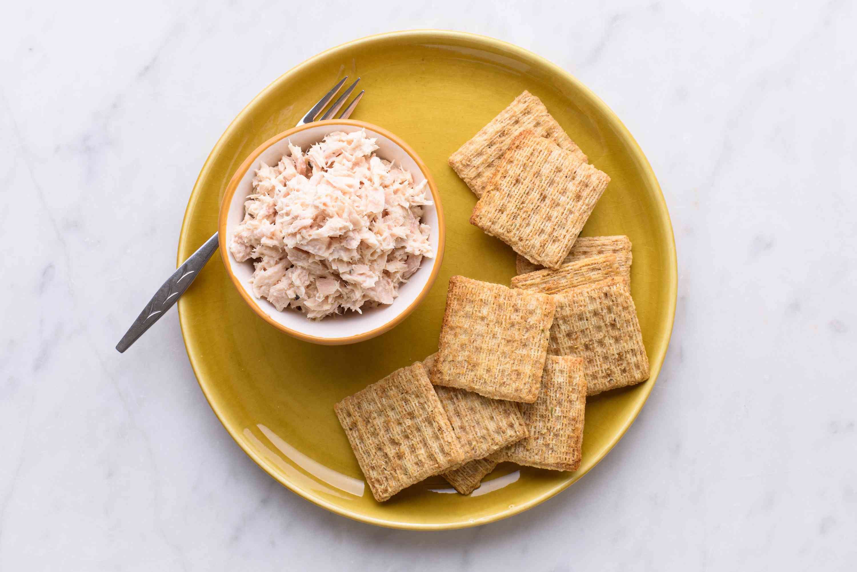 tuna and crackers on a plate