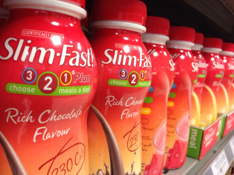 Row of slimfast shake bottles on a store shelf