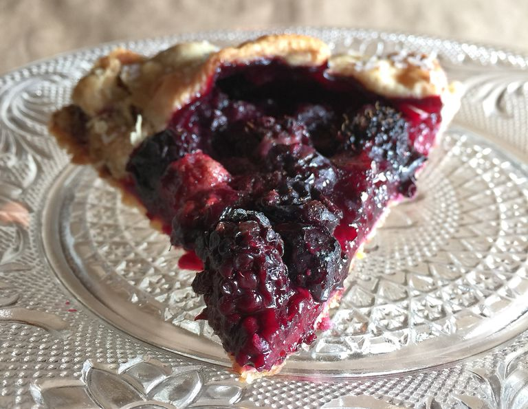 fresh berry pie on a clear plate