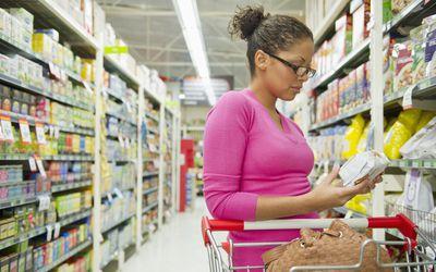 woman reading ingredients label