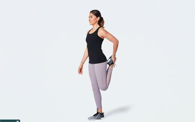 woman doing standing quad stretch