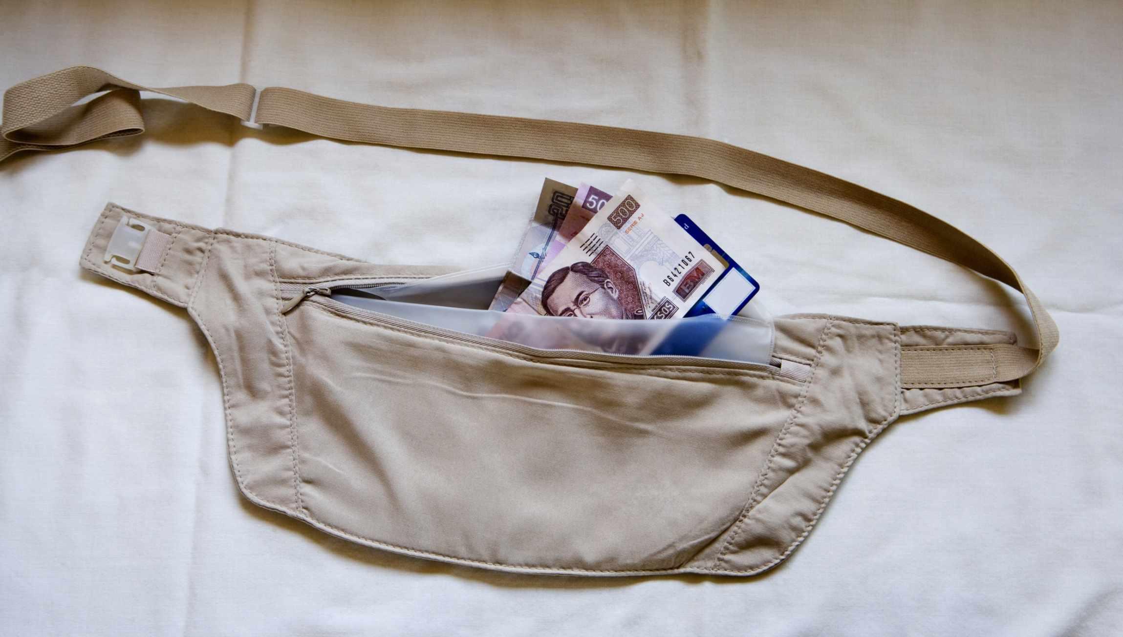 Money belt open on bed