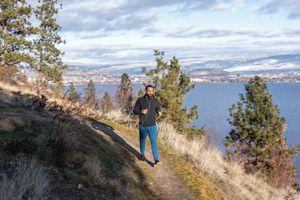 man walking fast on coastal, mountain trail