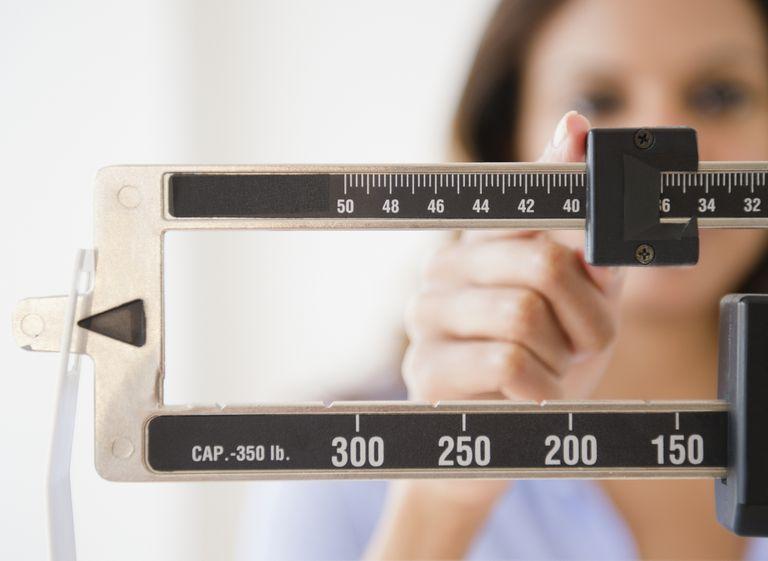 woman's finger adjusting scale