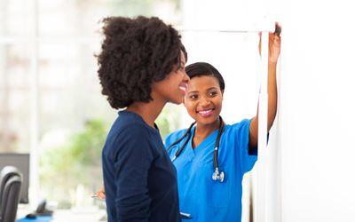 Nurse measuring woman's height