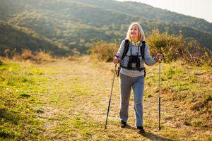 Woman walking with walking sticks