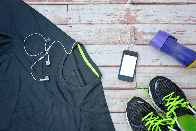 Running gear including shirt, sneakers, headphones, and water bottle