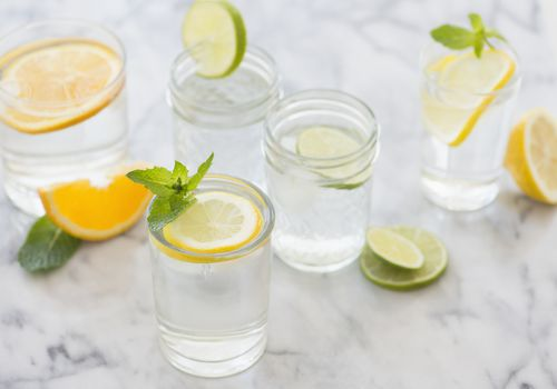 water in glasses with lemon, lime and orange