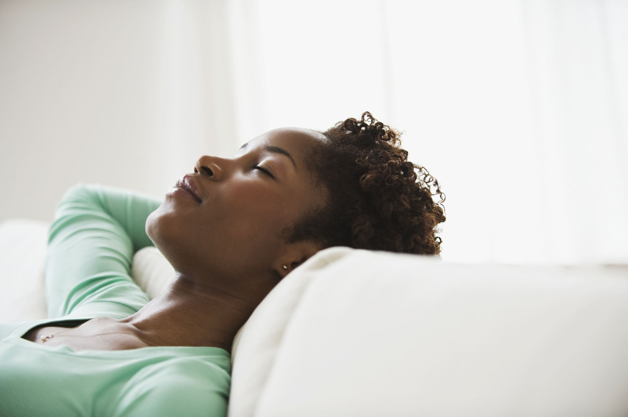 Woman napping on a sofa