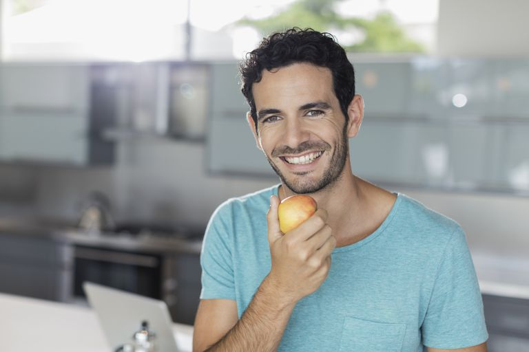 Man with apple is eating better.