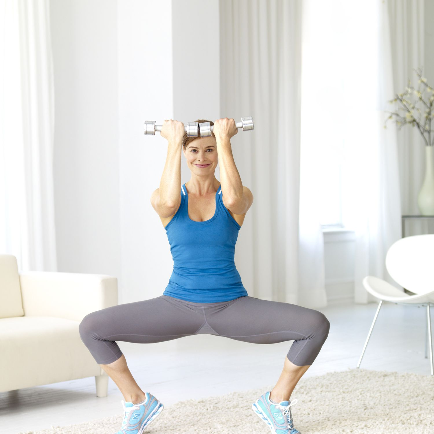 Brunette woman exercising at home