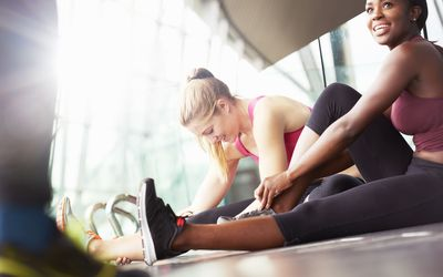 women stretching and exercising