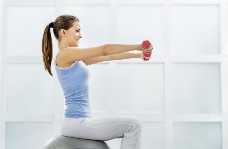 Smiling woman exercising.