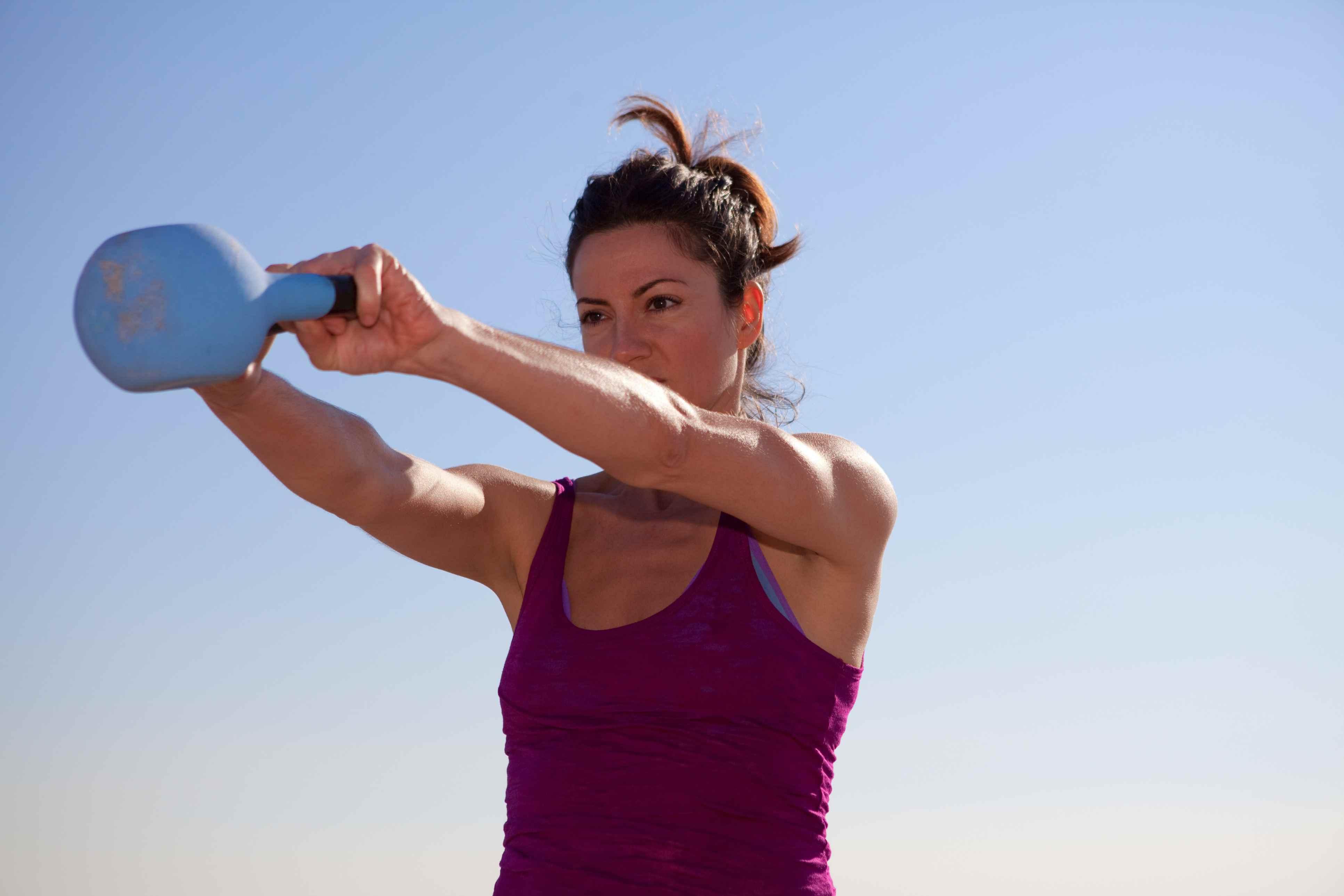 Woman swinging kettlebell