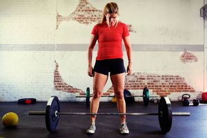 a woman weightlifting in a gym