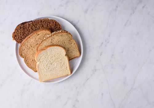 Different types of bread on a plate.