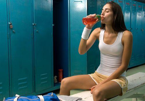 woman drinking gluten-free sports drink