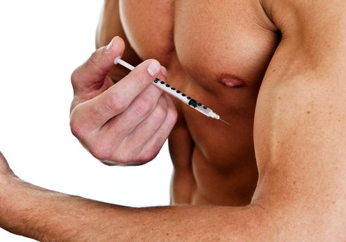 muscular man with syringe