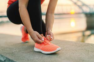 Runner tying her shoes before a long run