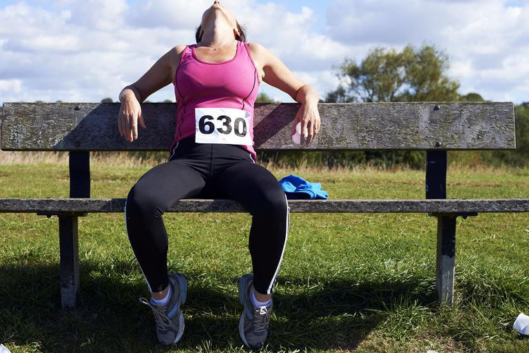 Runner resting on a park bench