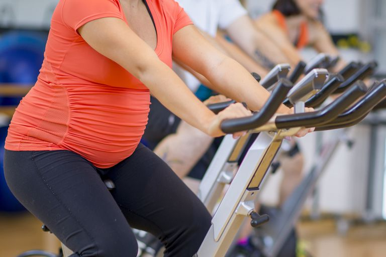pregnant woman indoor cycling
