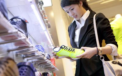 Female executive looking at running shoe