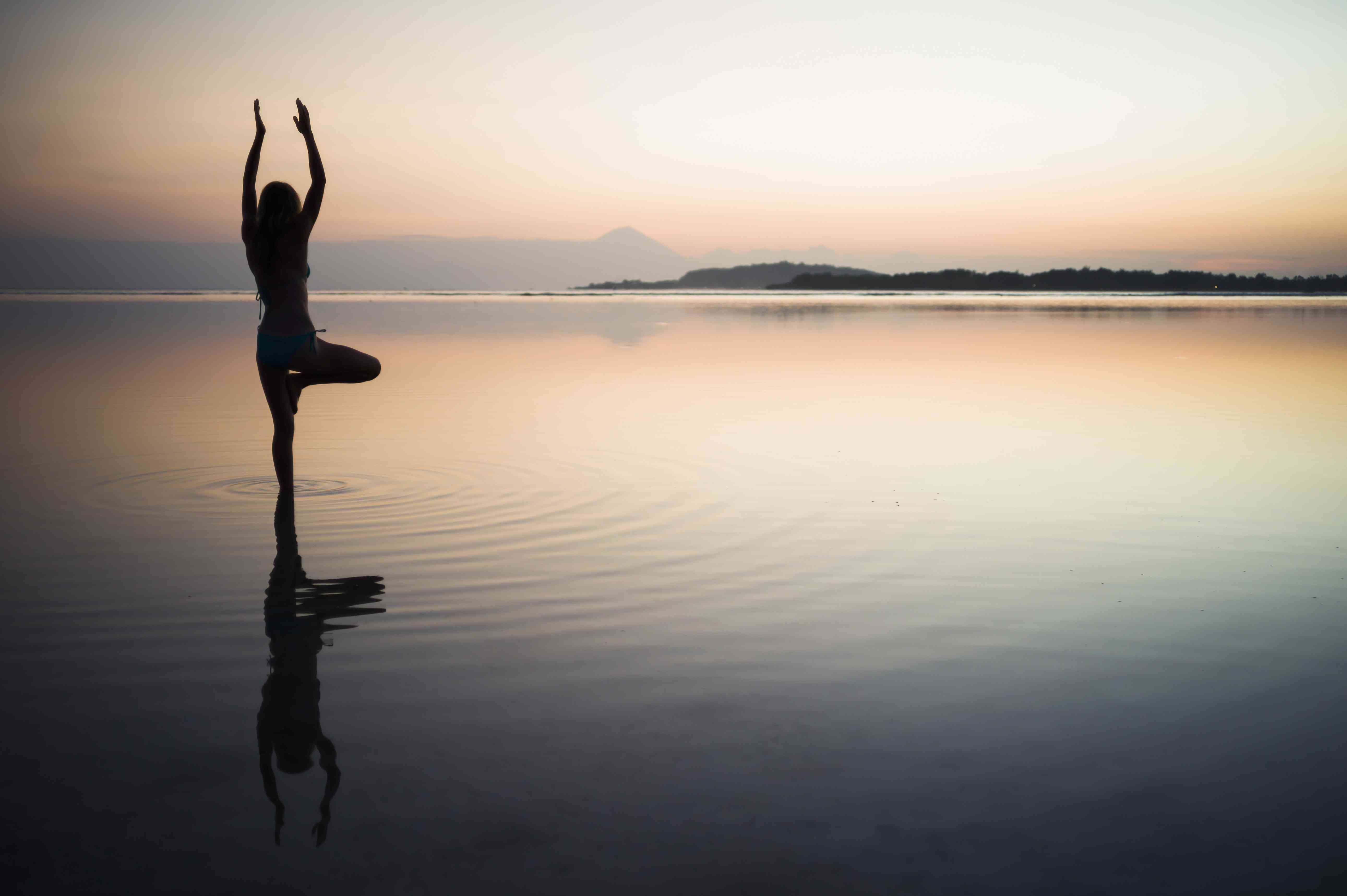 Woman doing yoga pose in water