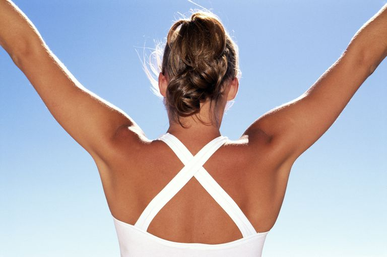 Woman stretching shoulders