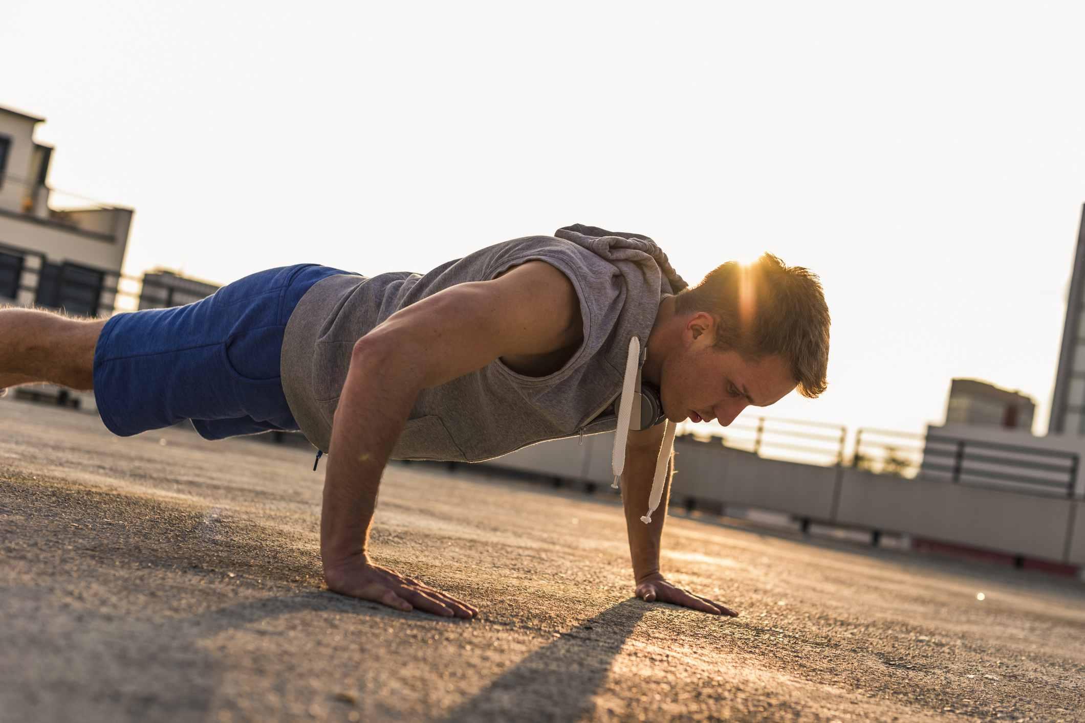 Young man exercing push ups
