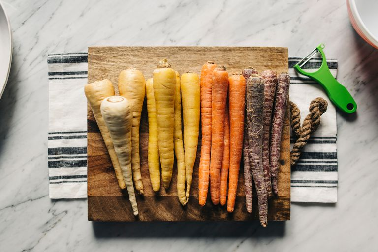 Colorful carrots on cutting board