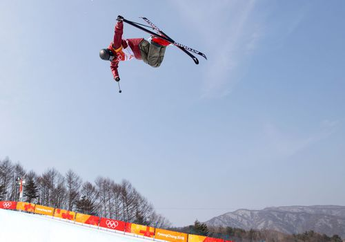 Athlete and the 2018 Winter Olympics doing a trick in freestyle skiing