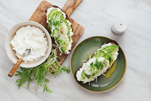 ricotta cheese served on toast with leafy greens