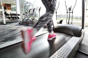 Woman's Legs Running on Treadmill