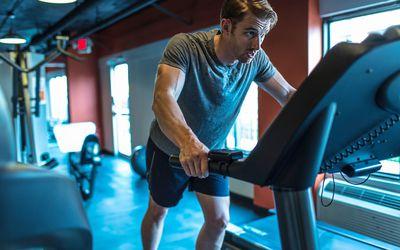 Man holding onto treadmill