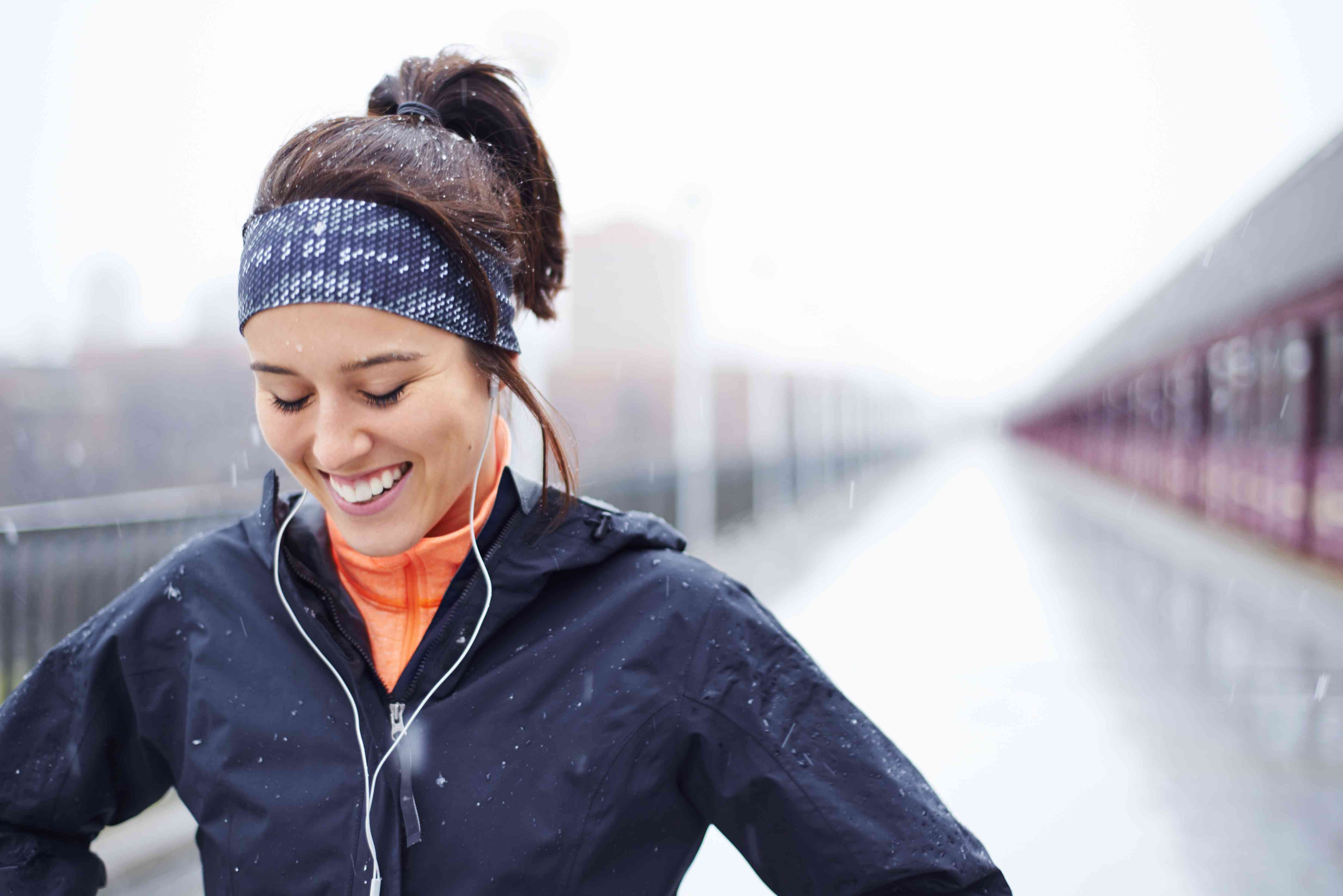 Young woman exercising in outside in the cold