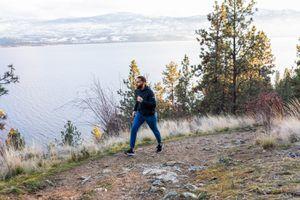 man walking fast on coastal mountain trail