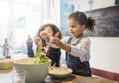 girl mixing salad
