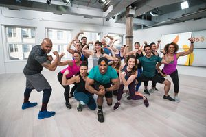 Group of people flexing muscles and smiling