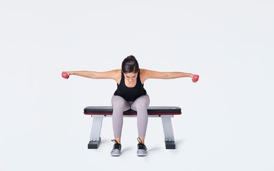 Woman doing reverse fly