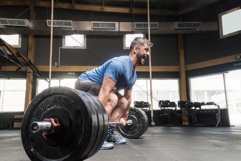 Man preparing to deadlift in a gym