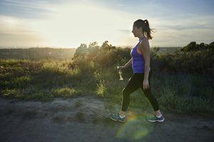 Woman walking with water bottle