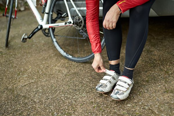 Person putting on cycling shoes