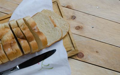 Load of sliced white bread on chopping board