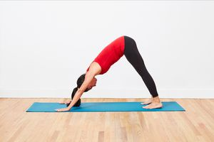 A woman in downward dog