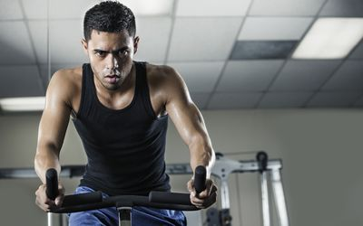 Young man training in gym