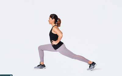 woman doing standing lunge stretch