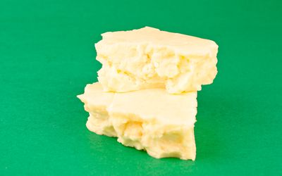 photo of Monterey Jack cheese on green background